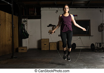 Woman using a jump rope at the gym