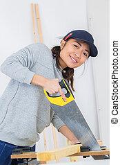 woman using a manual saw