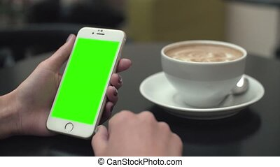Woman Using a Mobile Phone with Green Screen