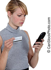 woman using a phone card