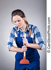 Woman using a plunger