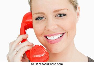 Woman using a retro phone