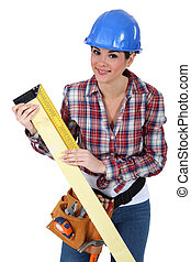 Woman using a right angle ruler