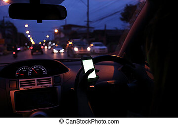 woman using a smart phone in car