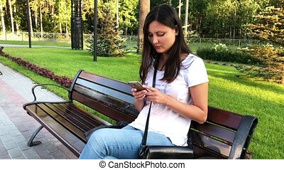 Woman using a smartphone in the park