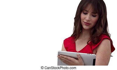 Woman using a tablet computer before looking at the camera