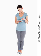 Woman using a tablet computer against a white background