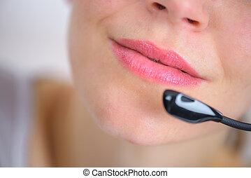 Woman using a telephone head set