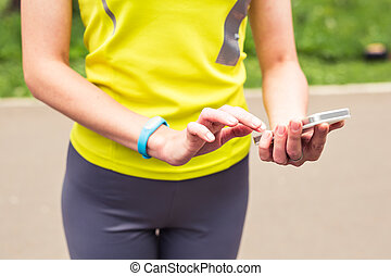 Woman using activity tracker