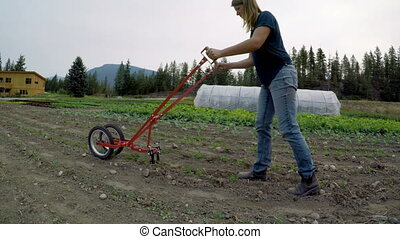 Woman using agricultural equipment in the farm 4k