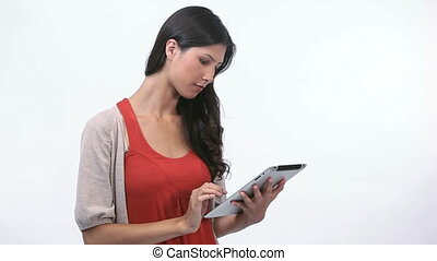 Woman using an ebook - Video of a woman using an ebook