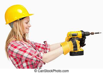 Woman using an electric screwdriver