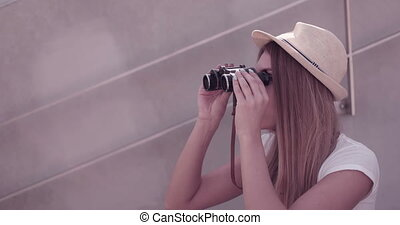 Woman Using Binoculars - Attractive young woman using...