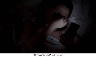 Woman using cellphone on bed - Beautiful young Woman Lying ...
