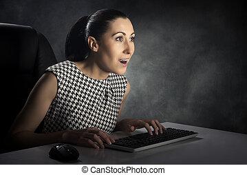 Woman using computer.
