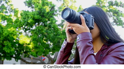 Woman using digital camera 4k - Beautiful woman using...