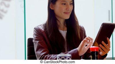 Woman using digital tablet at office 4k - Beautiful woman...