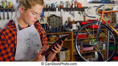 Woman using digital tablet at workshop 4k - Beautiful woman...