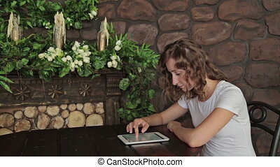 Woman using digital tablet computer at home