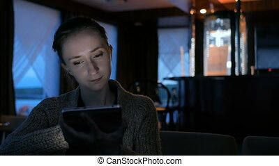 Woman using digital tablet computer device in cafe