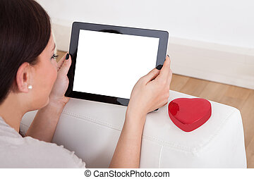 Woman Using Digital Tablet For Online Dating