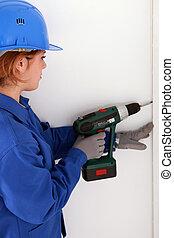 Woman using drill