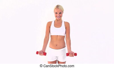 Woman using dumbbells isolated on a white background