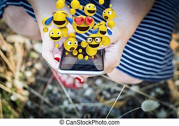 woman using emojis to chat