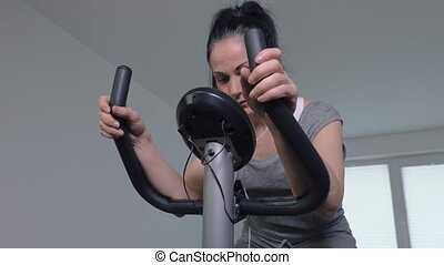 Woman using exercise bike