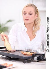 Woman using griddle