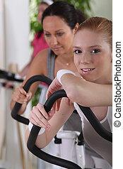 Woman using gym equipment