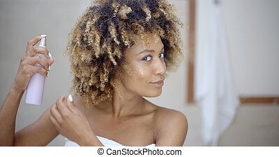 Woman Using Hair Spray In Bathroom - Young woman in towel ...