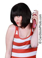 woman using hair spray