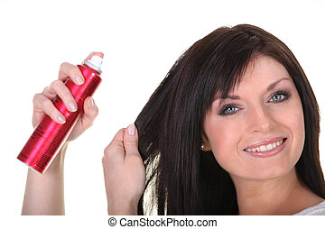Woman using hairspray