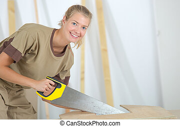 Woman using handsaw
