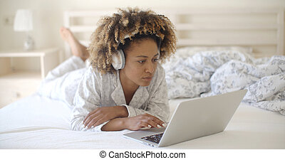Woman Using Her Laptop In Bed