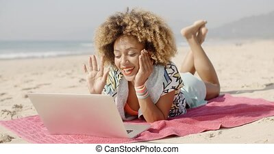 Woman Using Her Laptop Outdoor