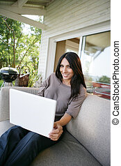 Woman using her laptop outdoors