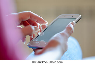 Woman Using Her Mobile Smart Phone at Home. Close-up of...