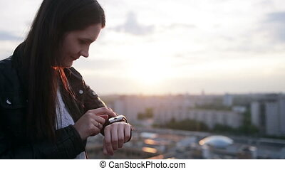 Woman using her smartwatch touchscreen device.