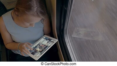 Woman Using Her Tablet In The Train