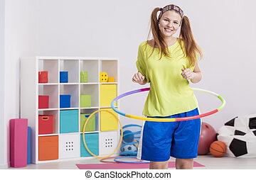 Woman using hula hoop