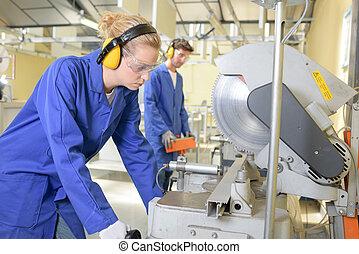 Woman using industrial circular saw
