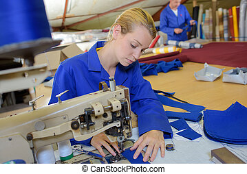 Woman using industrial sewing machine