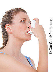 Woman using inhaler for asthma