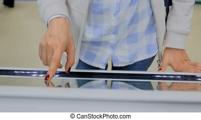 Woman using interactive touchscreen display - Woman hand...