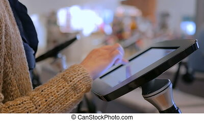 Woman using interactive touchscreen display tablet at jewish...