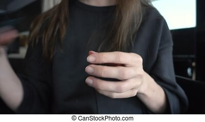 Woman using lancelet on finger testing blood sugar - Close...