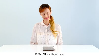 Woman using laptop on table against white background 4k