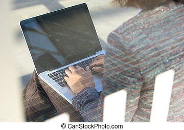 Woman using laptop outside